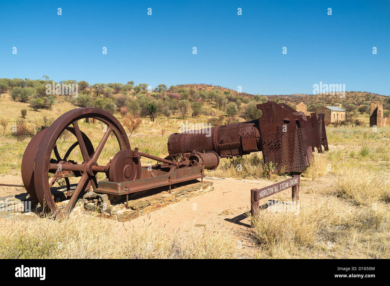 Ruins of an old steam engine at Arltunga Historic Reserve, East MacDonnell Ranges in the Red Centre of the Northern - Stock Image