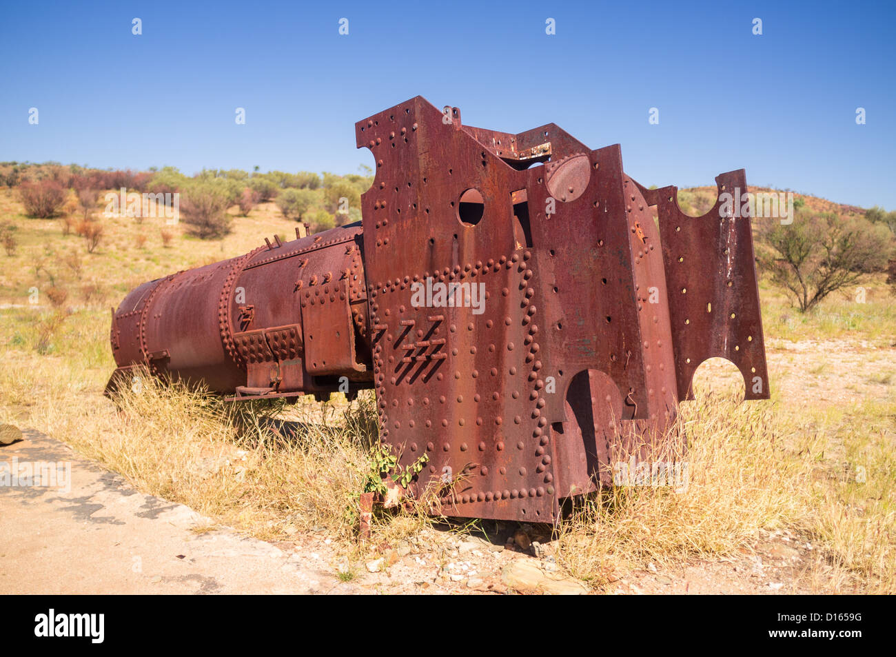 Ruins of an old steam engine at Arltunga Historic Reserve, East MacDonnell Ranges, Northern Territory in the Red - Stock Image