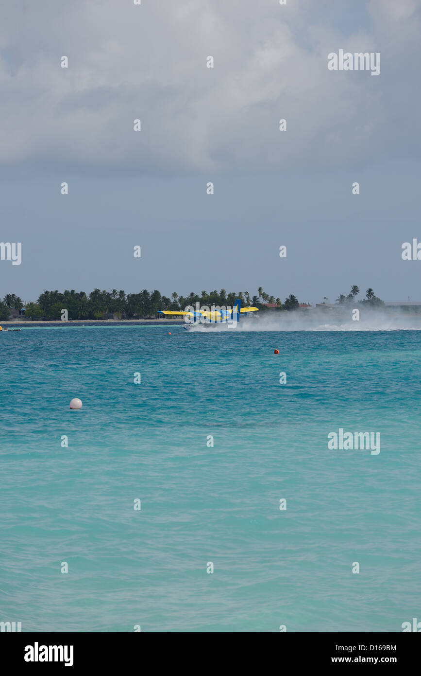 Maldives seaplane takeoff - Stock Image