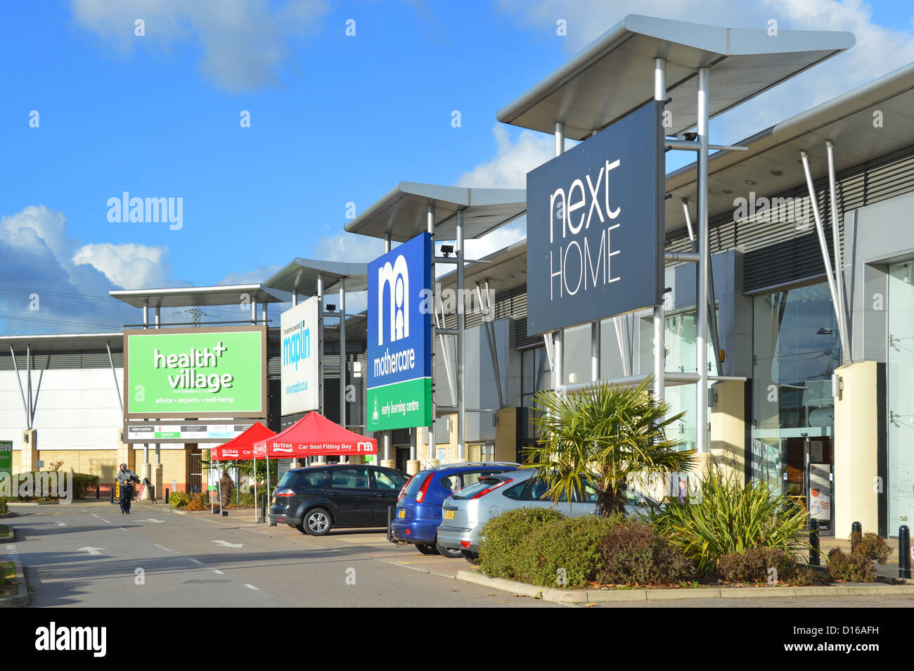 retail park shopping units and large signs - Stock Image