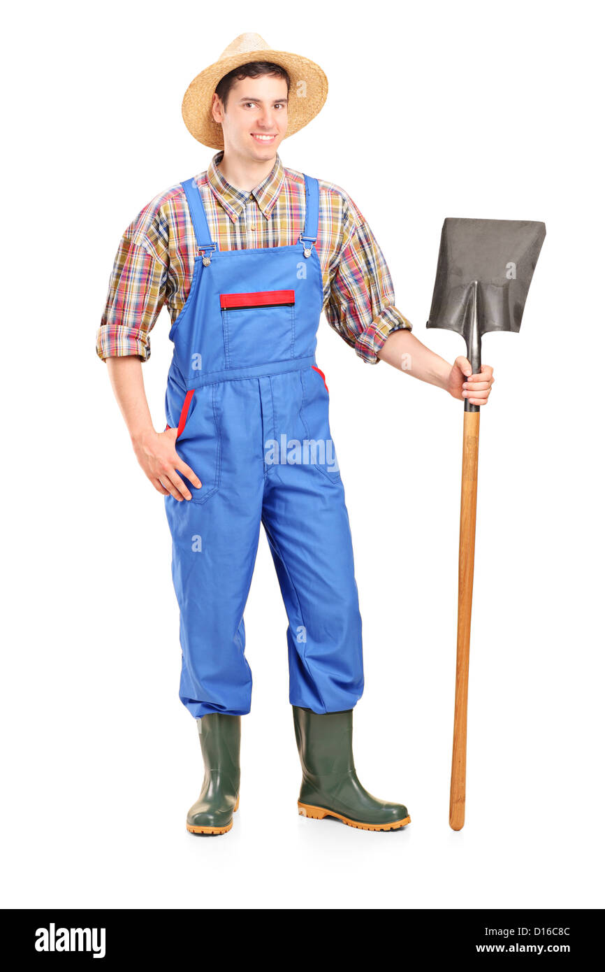 Full length portrait of a male agricultural worker holding a shovel isolated on white background - Stock Image