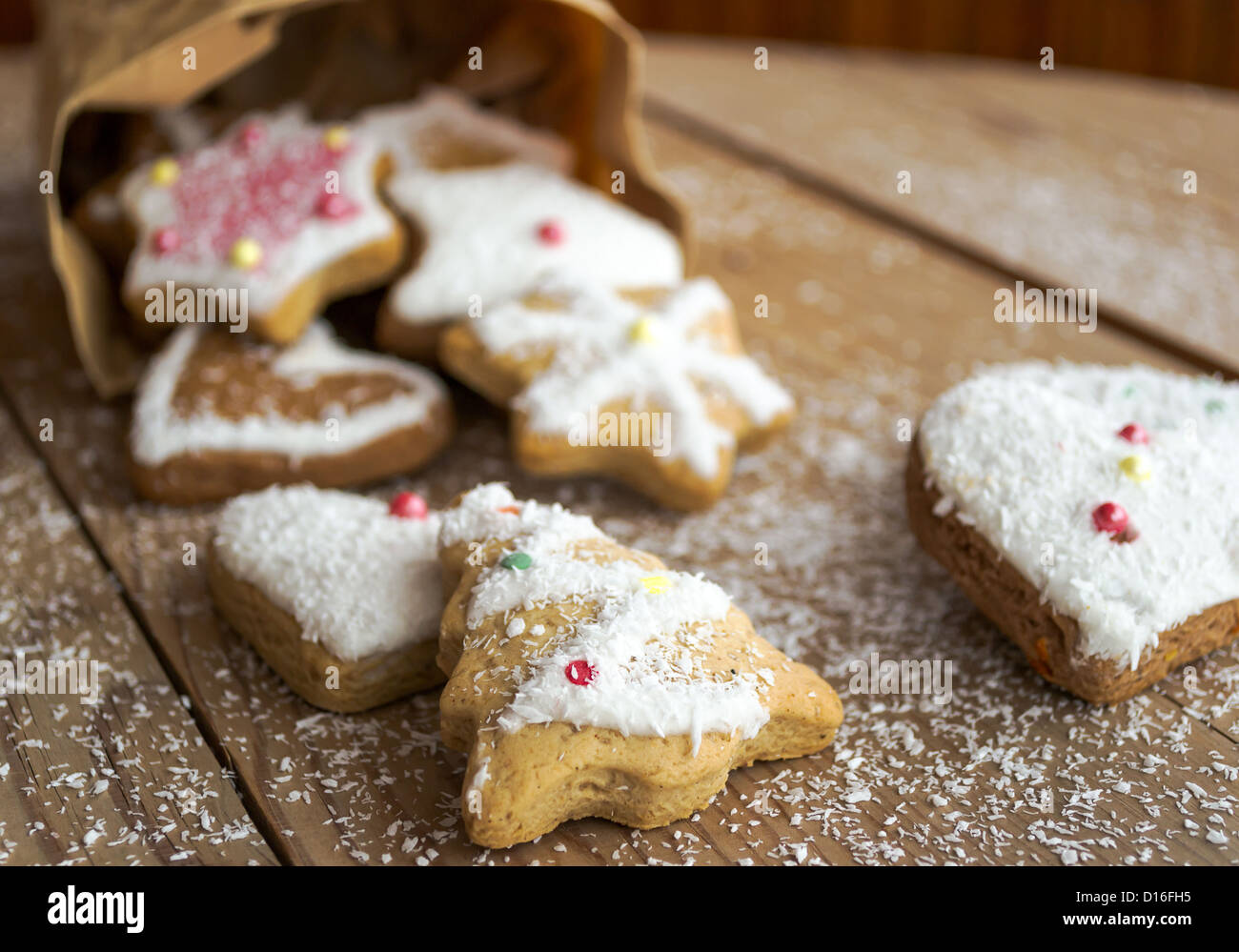 Homemade christmas cookies with decoration on wooden table - Stock Image