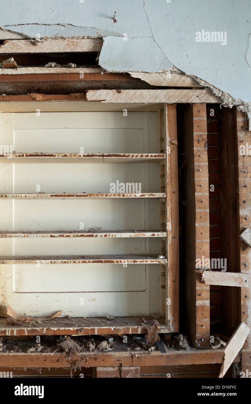 A house that has sat vacant for years shows signs of wear and tear. Stock Photo