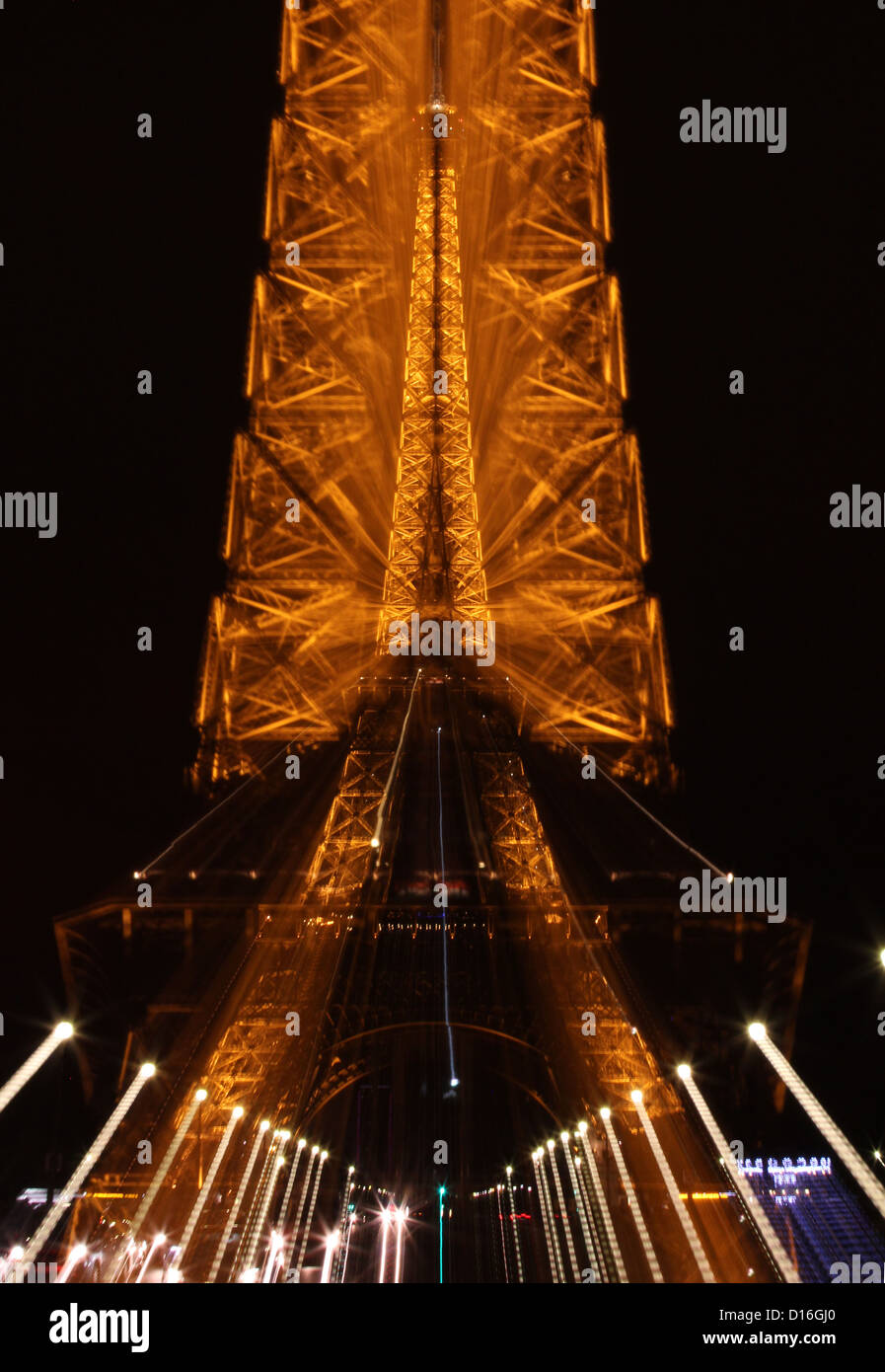 Exceptionally unique luminous Eiffel Tower at night, radiating light into the sky in a spectacular hallucinatory - Stock Image