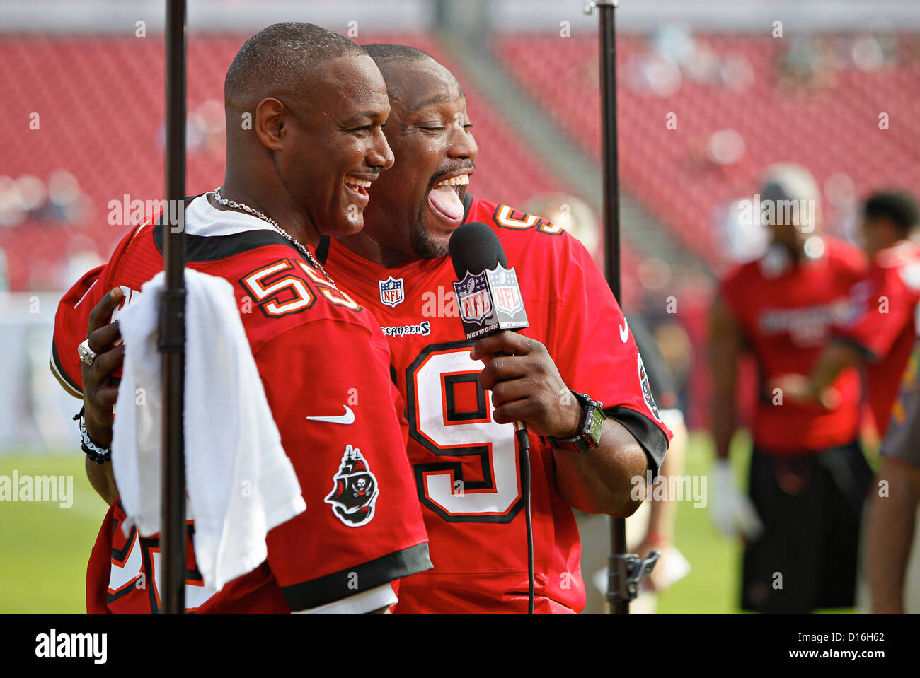 Dec. 9, 2012 - Florida, U.S. - Tampa) Tampa Bay Buccaneers 2002 Superbowl team members Derrick Brooks, left, and - Stock Image