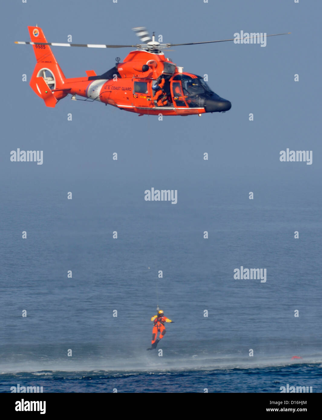 HERMOSA BEACH, Calif. - Petty Officer 1st Class Ty Aweau, an Aviation Survival Technician, conducts rescue swimmer - Stock Image