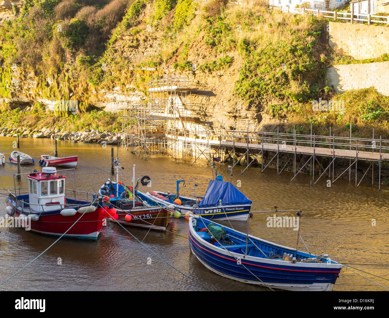 Civil engineering work to underpin a cliff where collapse would put a road and houses at risk Staithes North Yorkshire - Stock Image