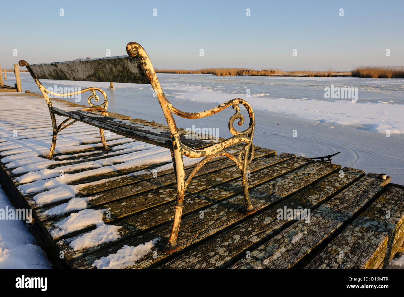 Bench facing frozen canal, Burgerveen, North Holland; Netherlands - Stock Image