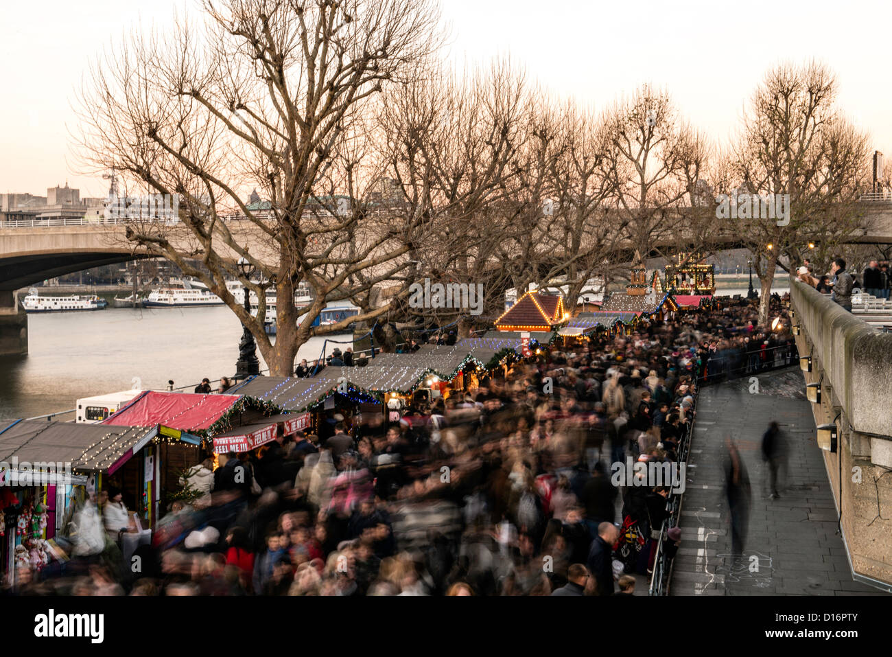 People doing Christmas shopping in South Bank London England Great Britain UK - Stock Image