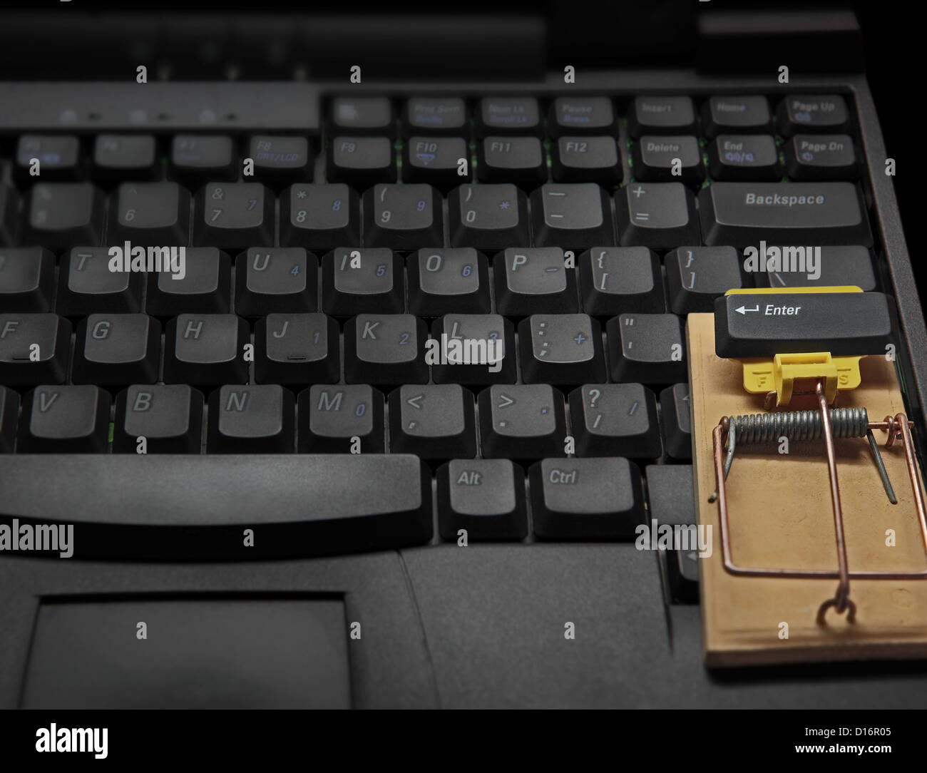 on the computer keyboard we see a mousetrap. Bad luck to those who will press the ENTER key with his or her finger! - Stock Image