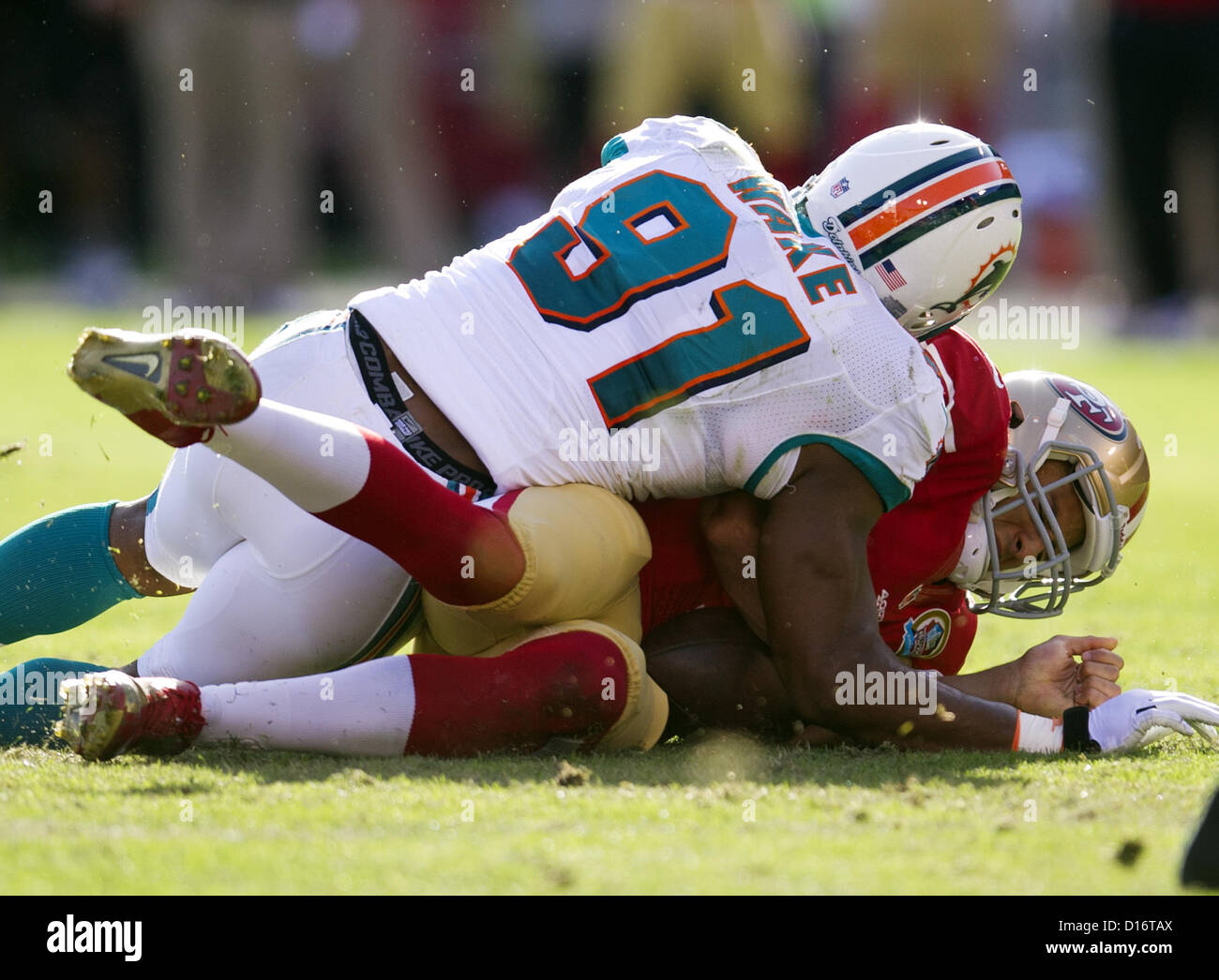 Dec. 9, 2012 - San Francisco, CA, USA - San Francisco 49ers quarterback Colin Kaepernick (7) sacked by Miami Dolphins - Stock Image