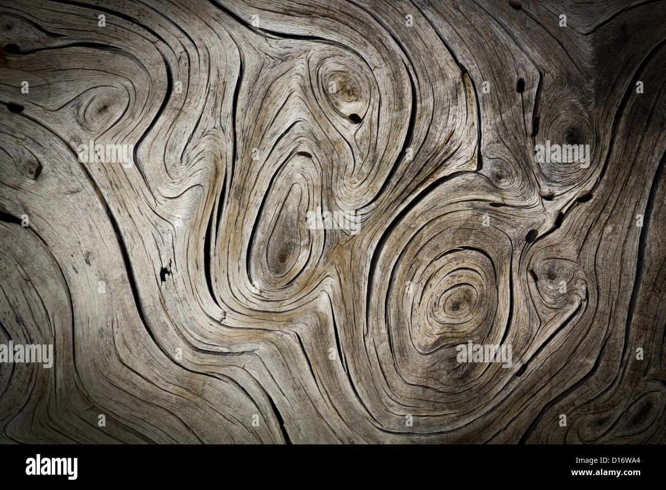Wooden Swirls Dark Organic Background Texture - Stock Image