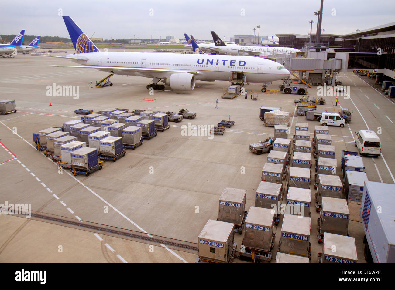 Tokyo Japan Narita International Airport NRT tarmac United Airlines gate area containers food supplies commercial - Stock Image