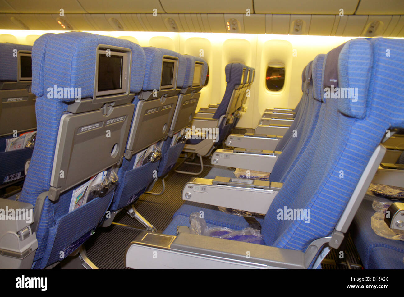 Tokyo Japan Narita International Airport NRT gate area concourse ANA Al Nippon Airways cabin onboard flight to Shanghai - Stock Image