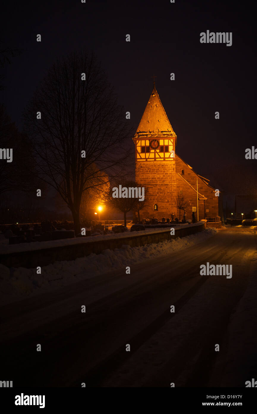 Illuminated church in winter time of Weiler in den Berge - Stock Image