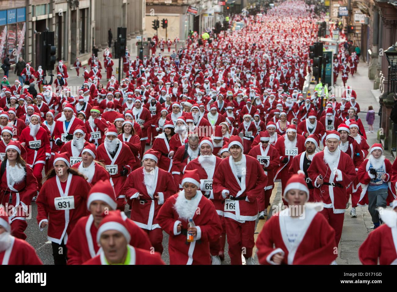 2,400 people undertake a 5km run dressed as Santa, in an annual run known as the Santa Dash, in Glasgow, Scotland, - Stock Image