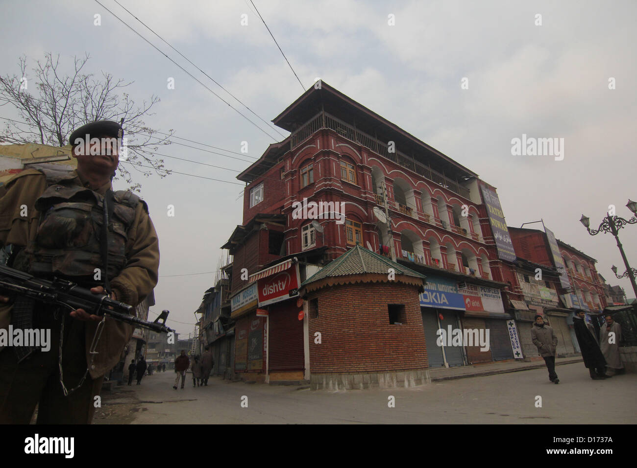 Dec. 10, 2012 - Indian policemen stand guard during  strick  to mark the International Human Rights Day in Srinagar, - Stock Image