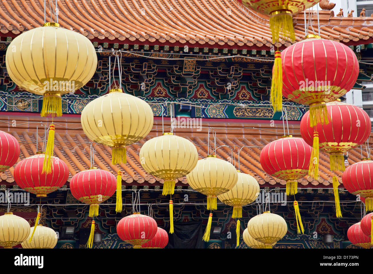 Chinese lanterns decorate Wong Tai Sin Temple. Also known as Sik Sik Yuen Wong Tai Sin Temple in Hong Kong China - Stock Image