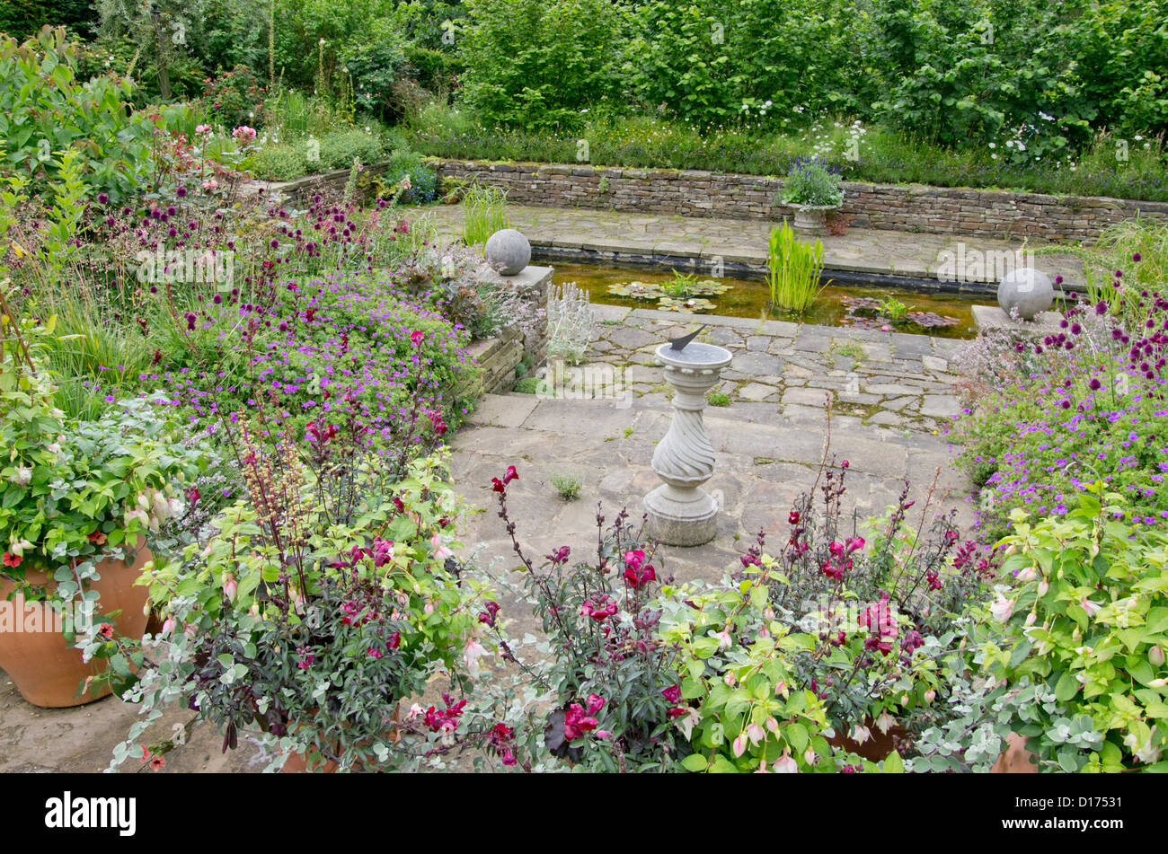 Hard Landscaping and pond at RHS Harlow Carr - Stock Image
