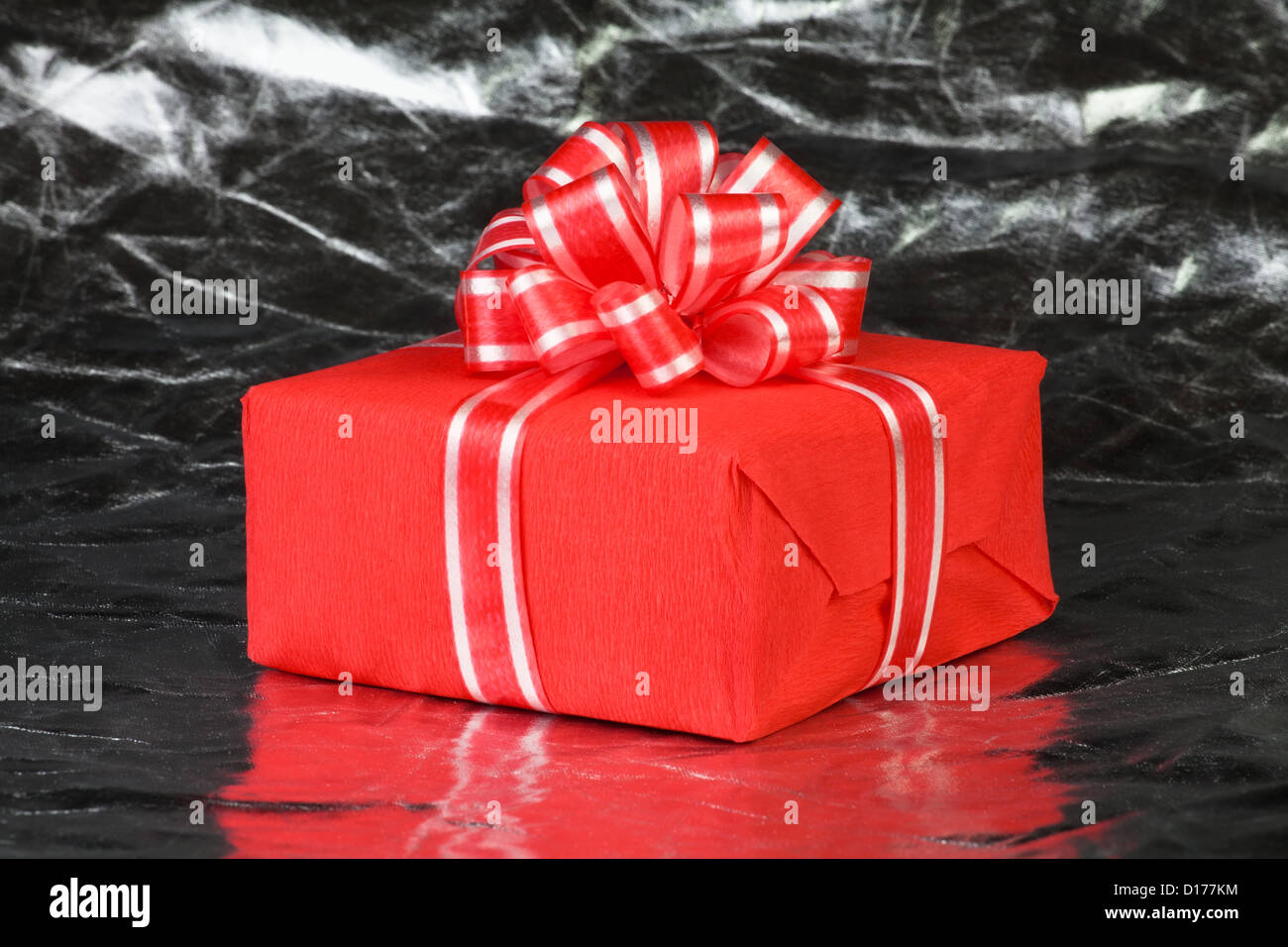 gift box present red on silver - Stock Image