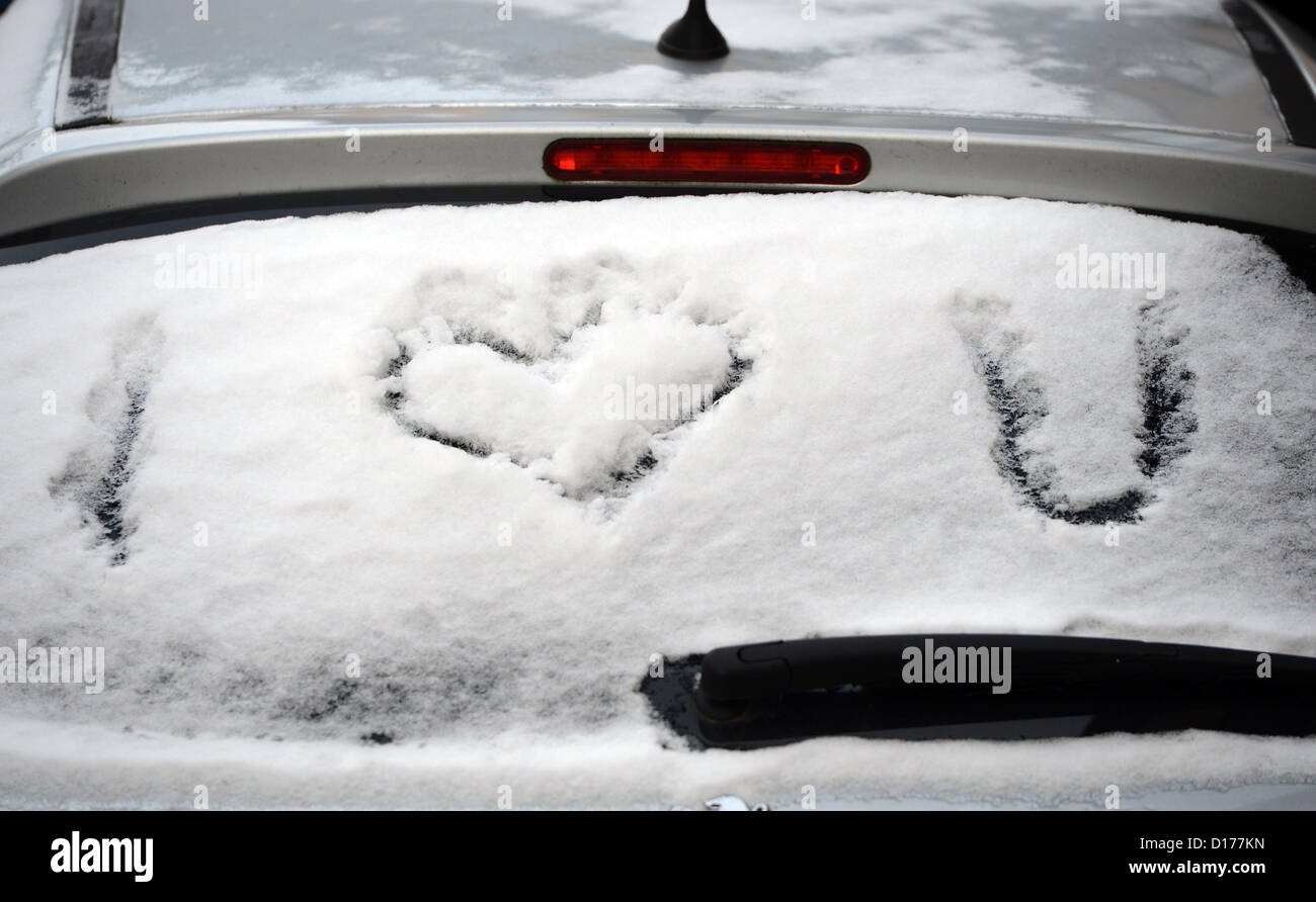 The letters I and U and a heart have been written into the snow on the rear windscreen of a car in Hanover, Germany, - Stock Image