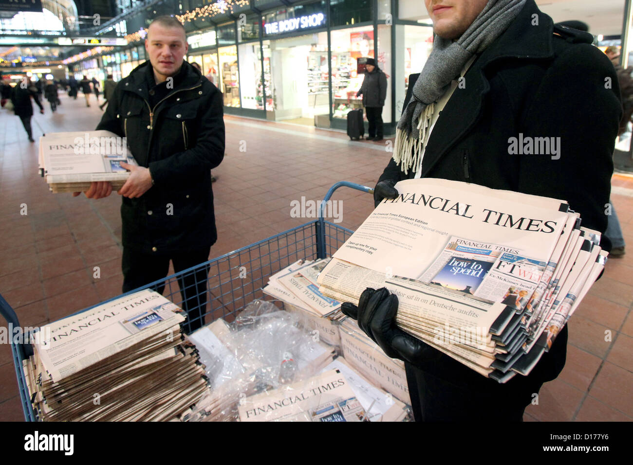 Copies of the English edition of the Financial Times are handed out at the central station in Hamburg,Germany, - Stock Image