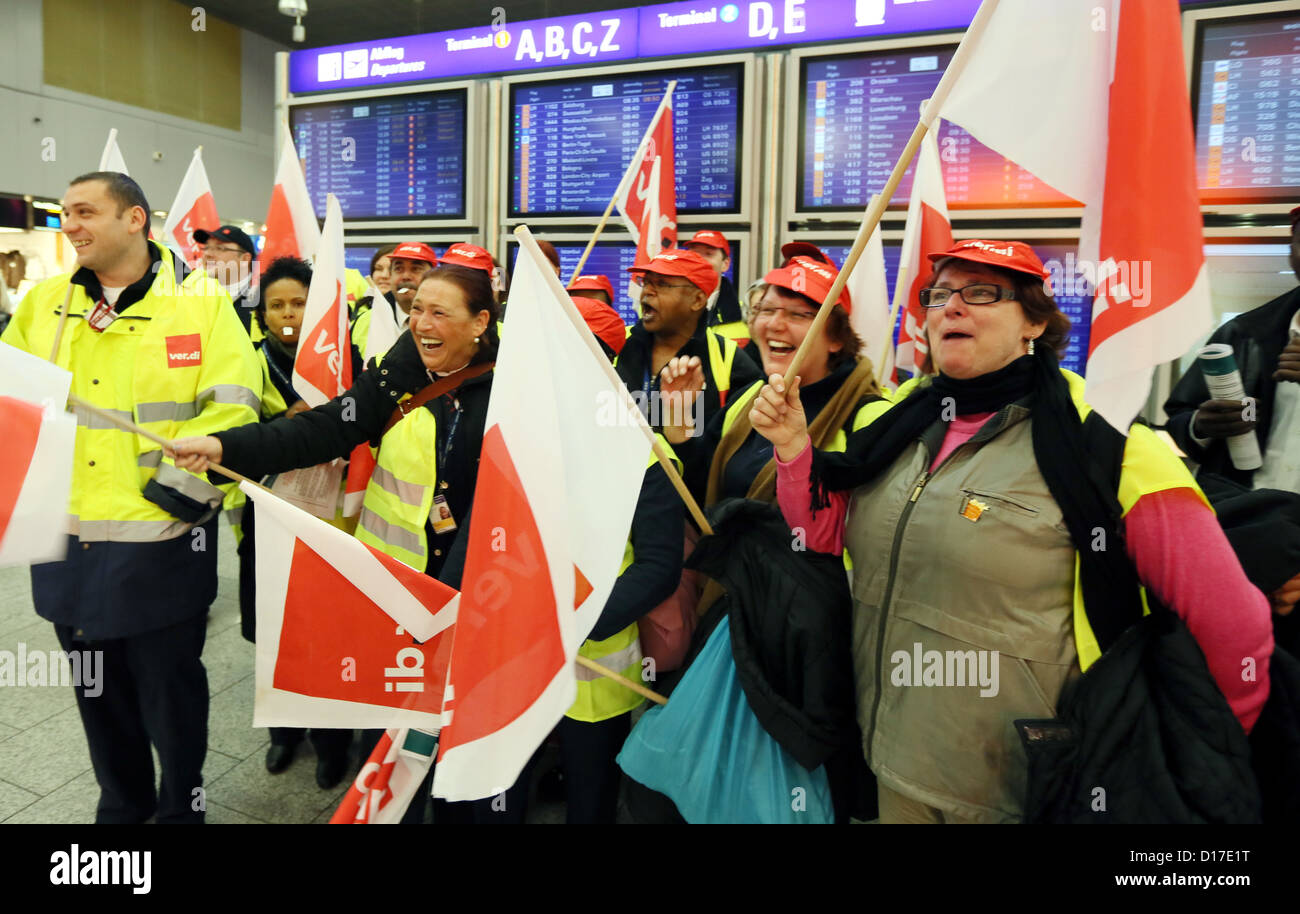 Security personnel gestures during a warning strike in front of the airport in Frankfurt Main, Germany, 10 December - Stock Image