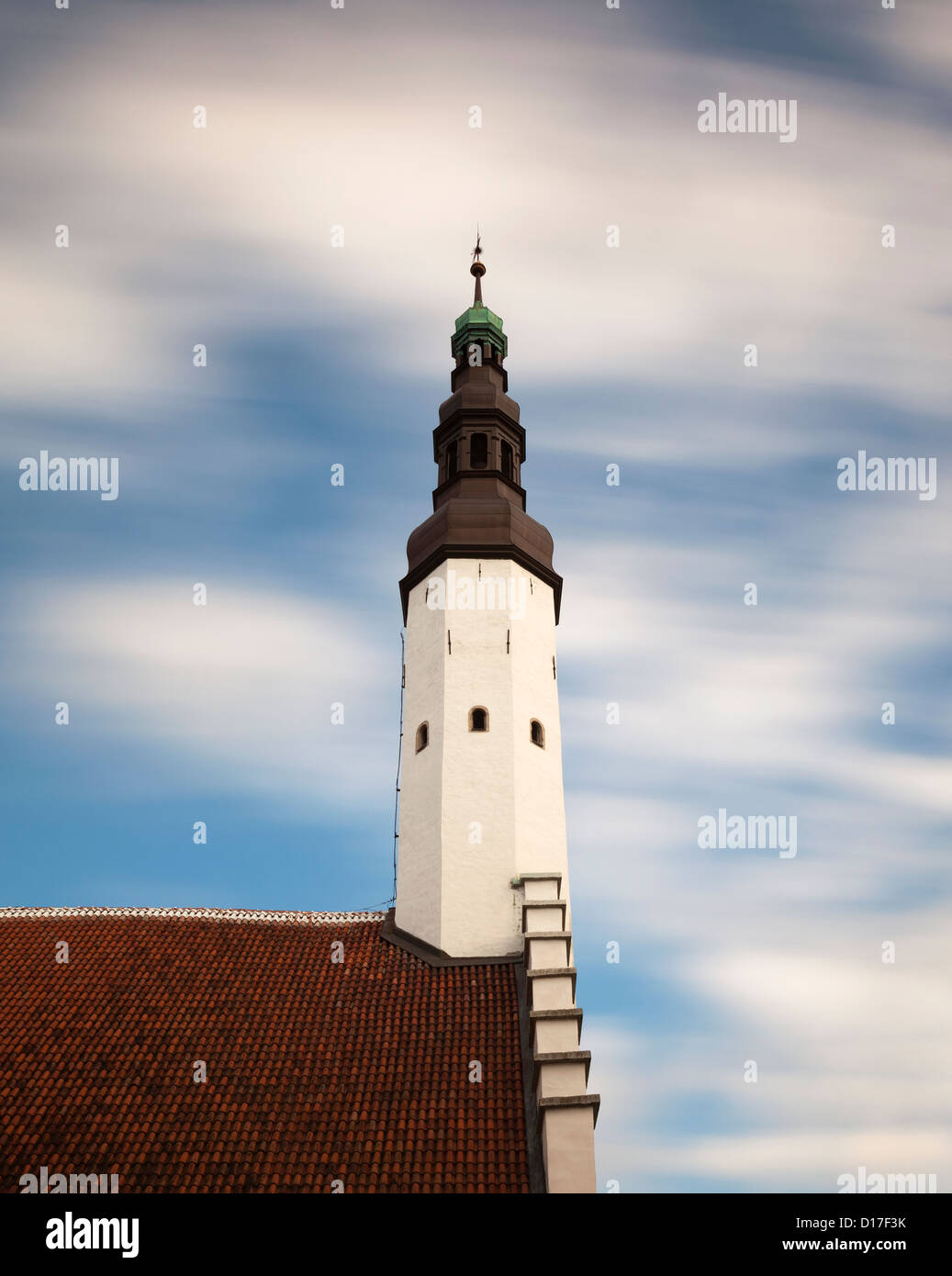 Church steeple against blue sky Stock Photo