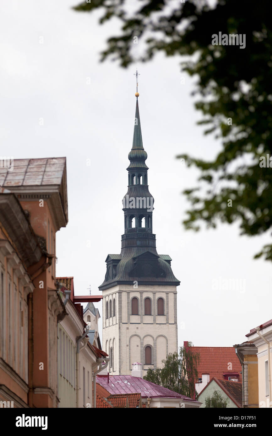 Church steeple overlooking town - Stock Image