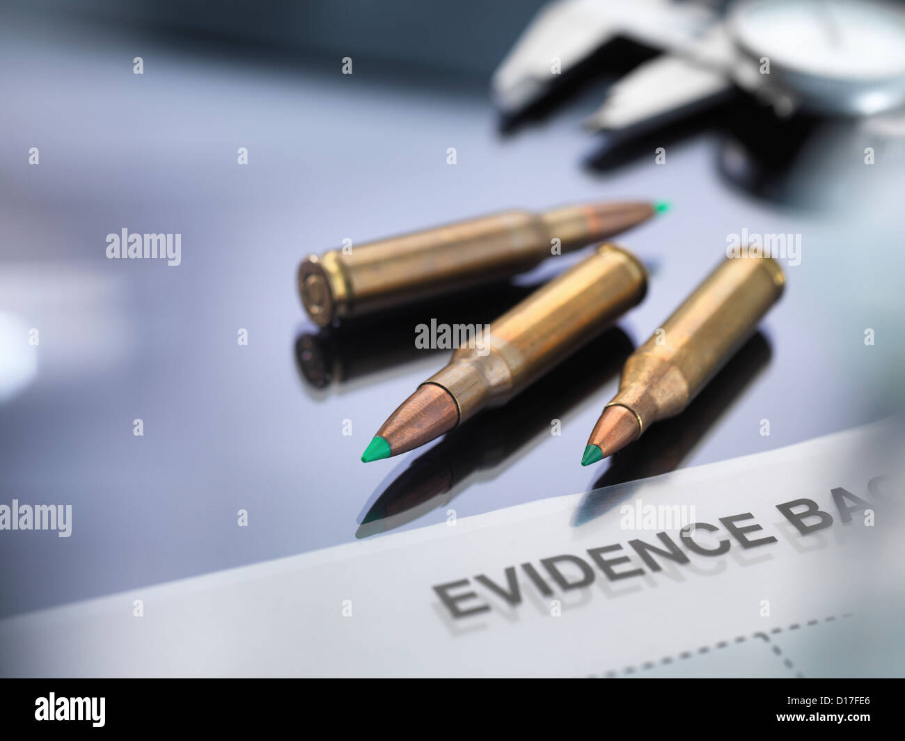 Bullets being tested and measured in a forensic lab. - Stock Image