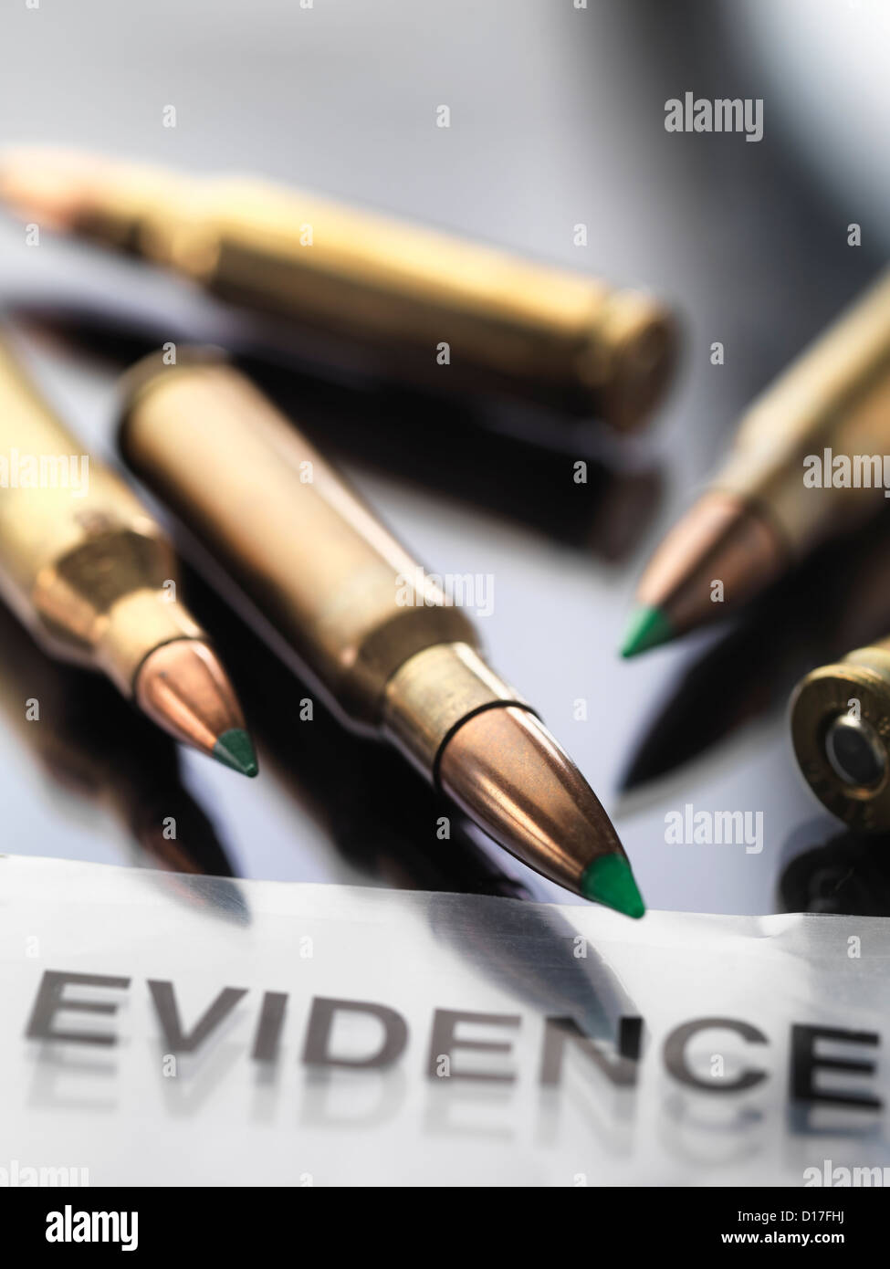 Bullets sitting on evidence bag in lab - Stock Image