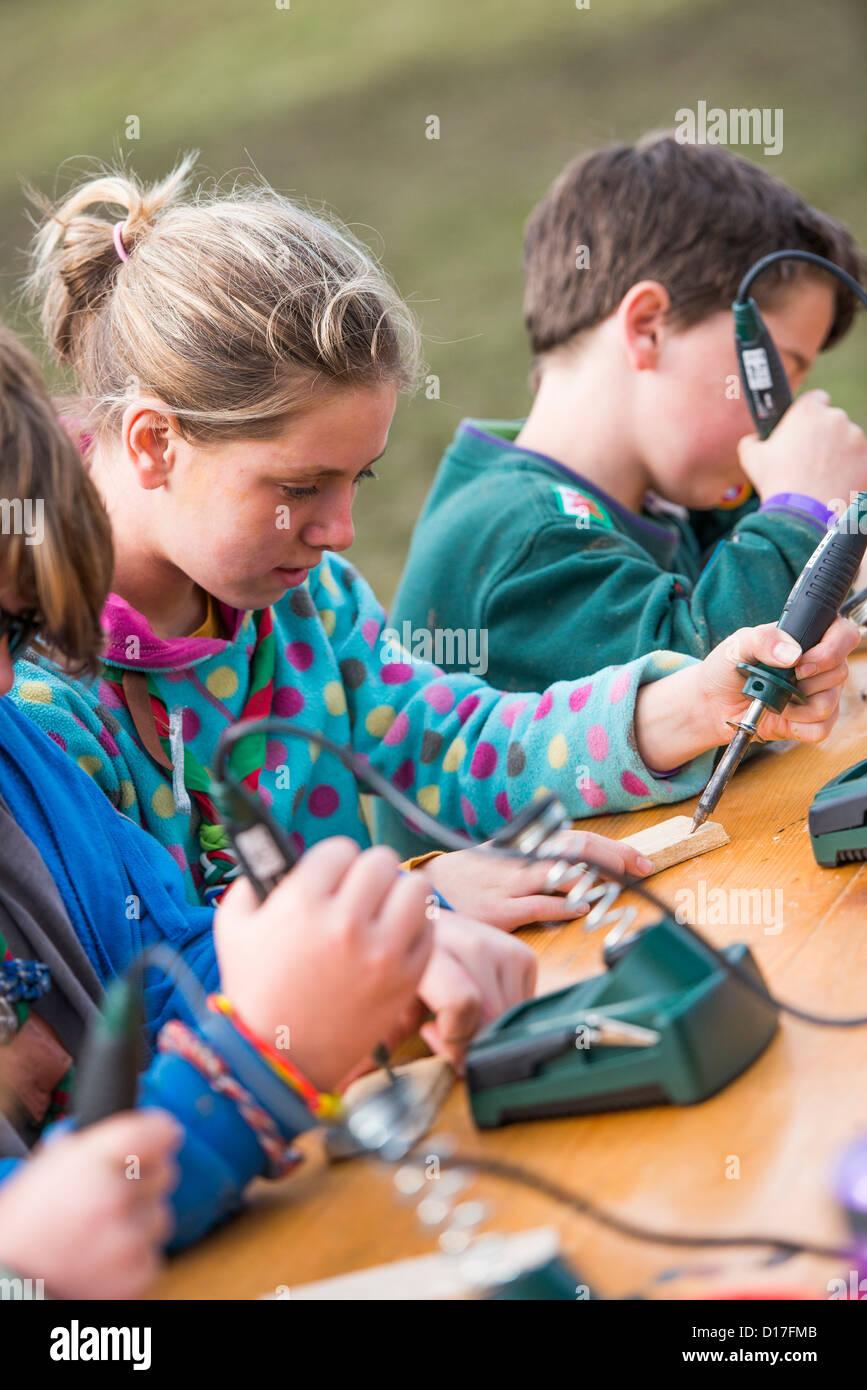 Scouts learning pyrography at a camp in Ceredigion, West Wales, UK - Stock Image