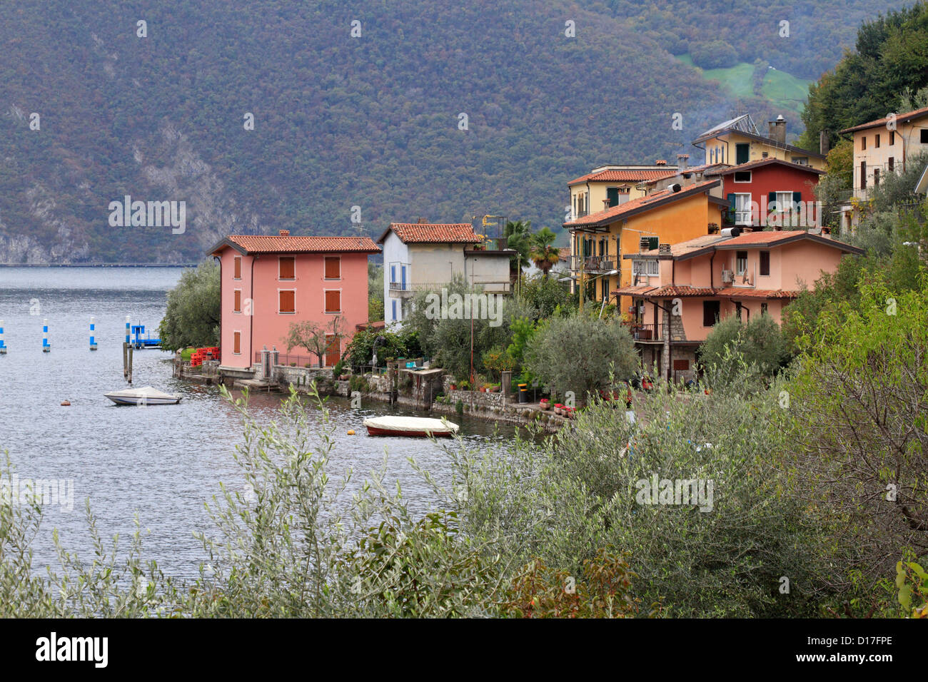 Colourful houses in Monte Isola on Lake Iseo, near Bergamo, Lombardy, Italy, Europe. - Stock Image