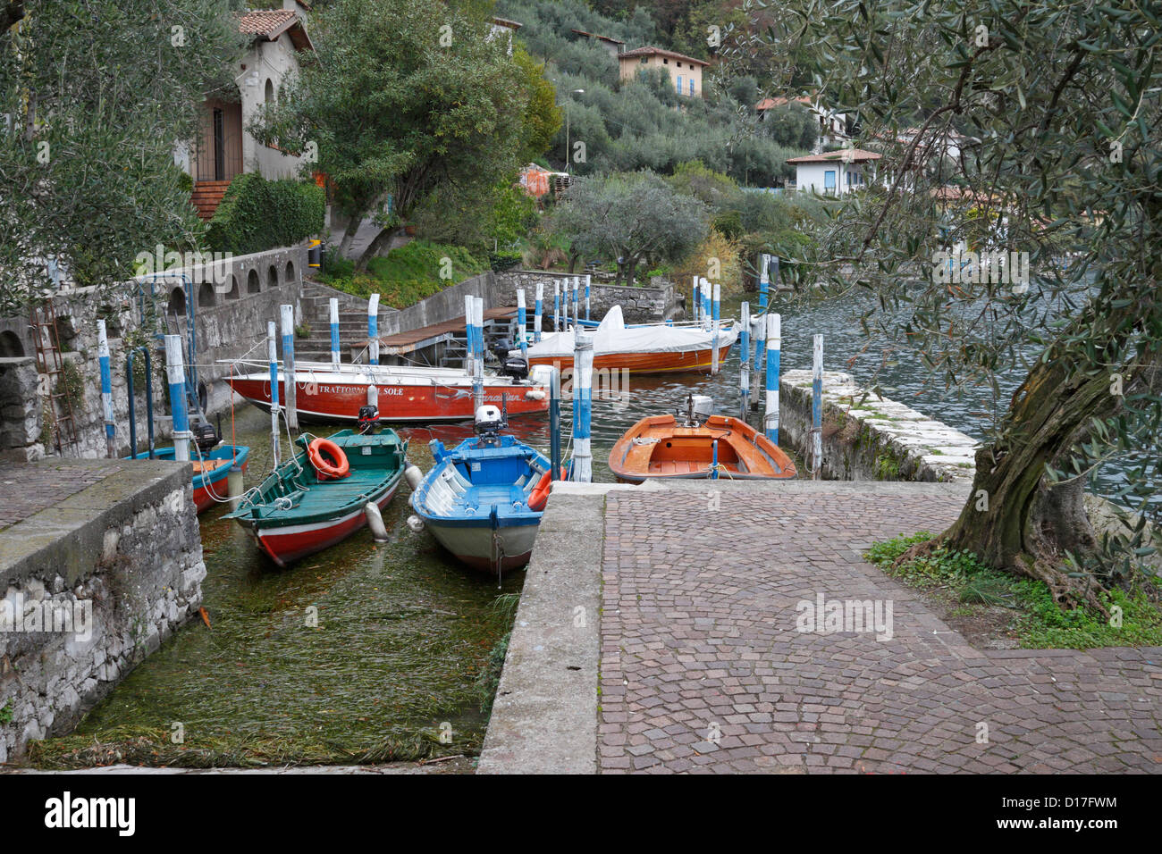 Boats in a small harbour in Monte Isola on Lake Iseo near Bergamo, Lombardy, Italy, Europe. - Stock Image