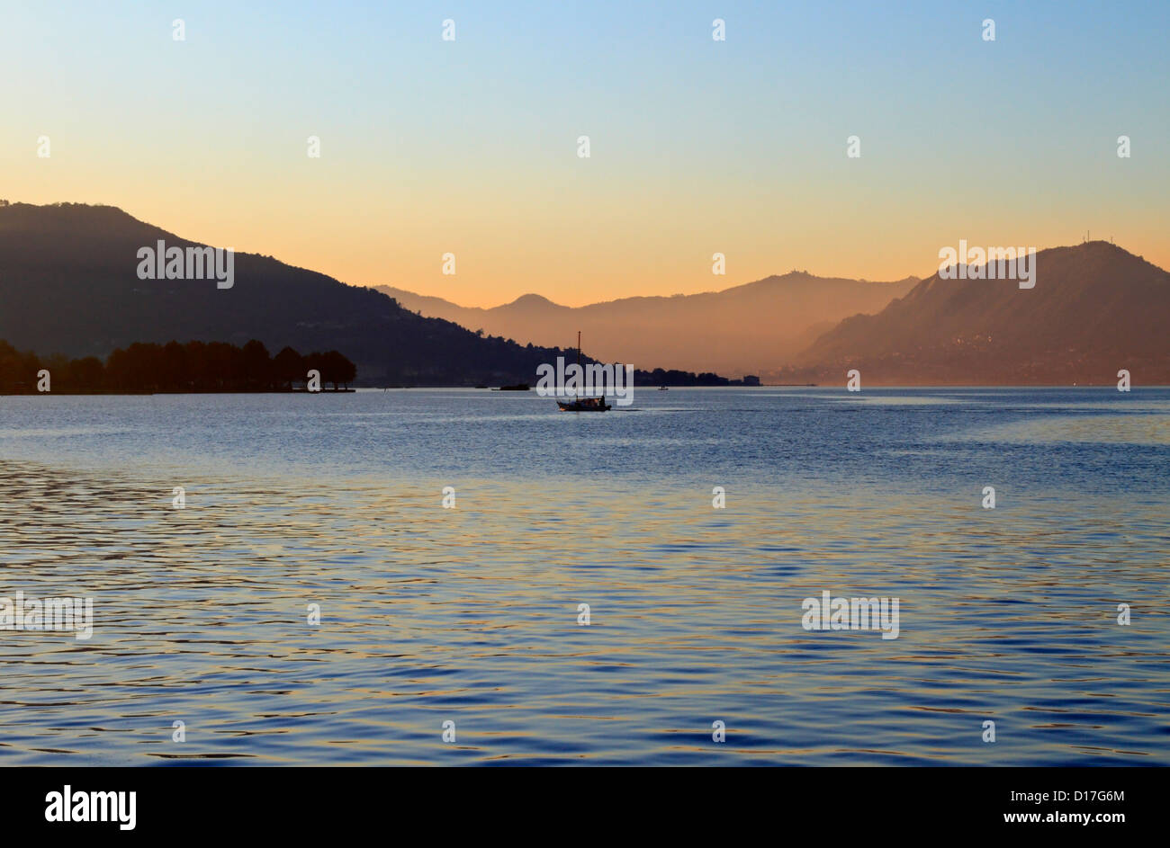 A fishing boat on Lake Iseo early evening, Iseo near Bergamo, Lombardy, Italy, Europe. - Stock Image