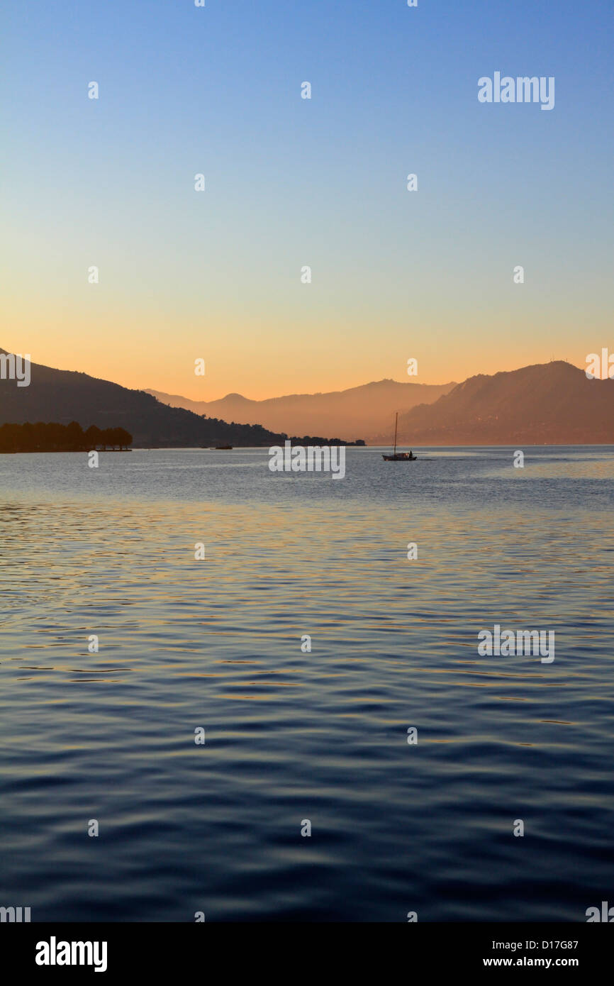 A fishing boat on Lake Iseo early evening, Iseo near Bergamo, Lombardy, Italy, Europe. - Stock Image
