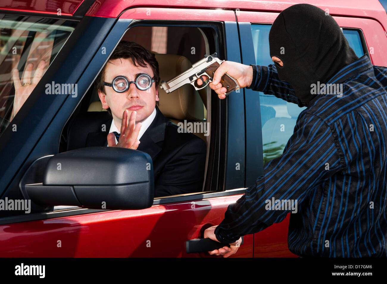 Robbery of the businessman in its car - Stock Image