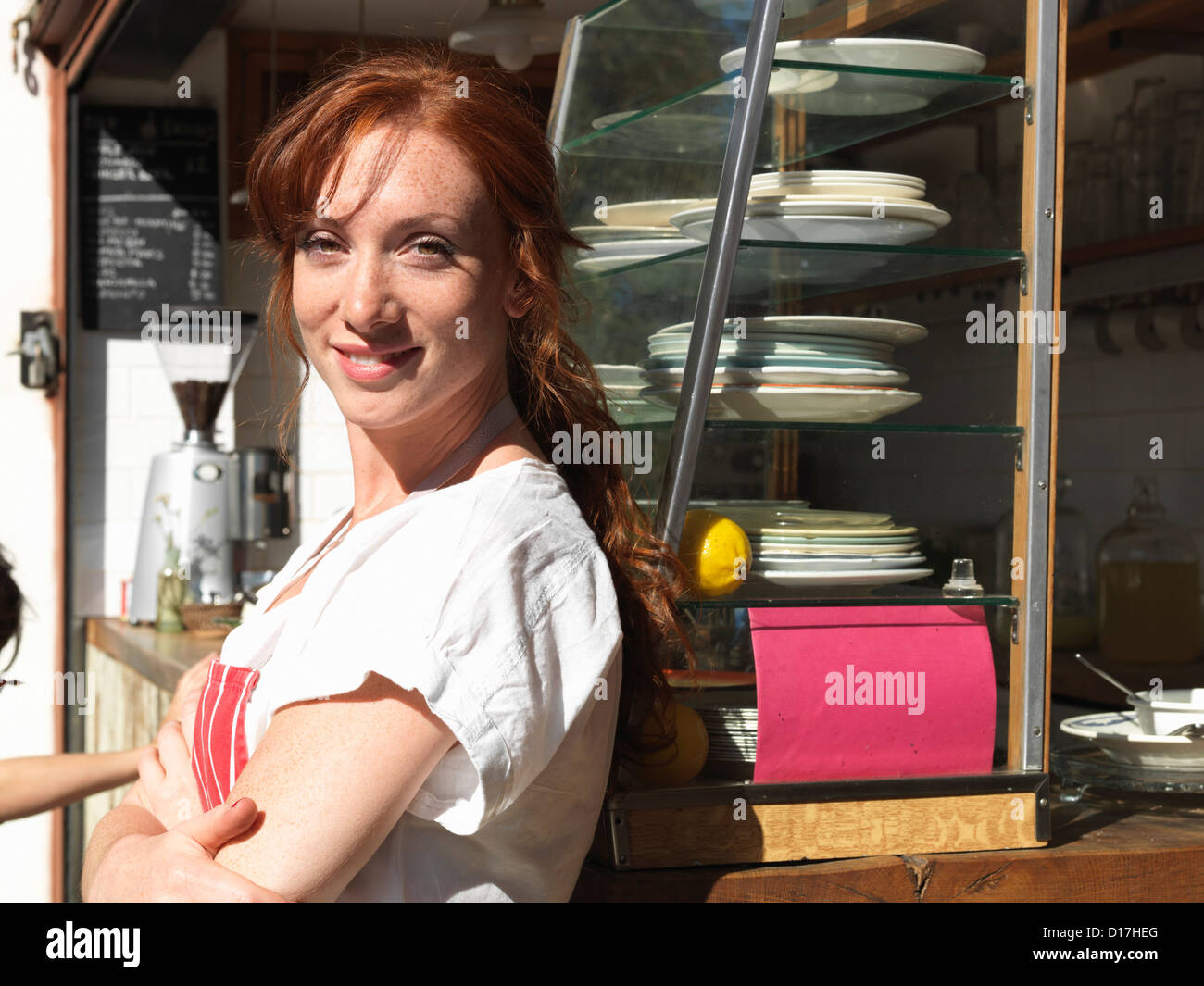 Woman working at sidewalk cafe Stock Photo