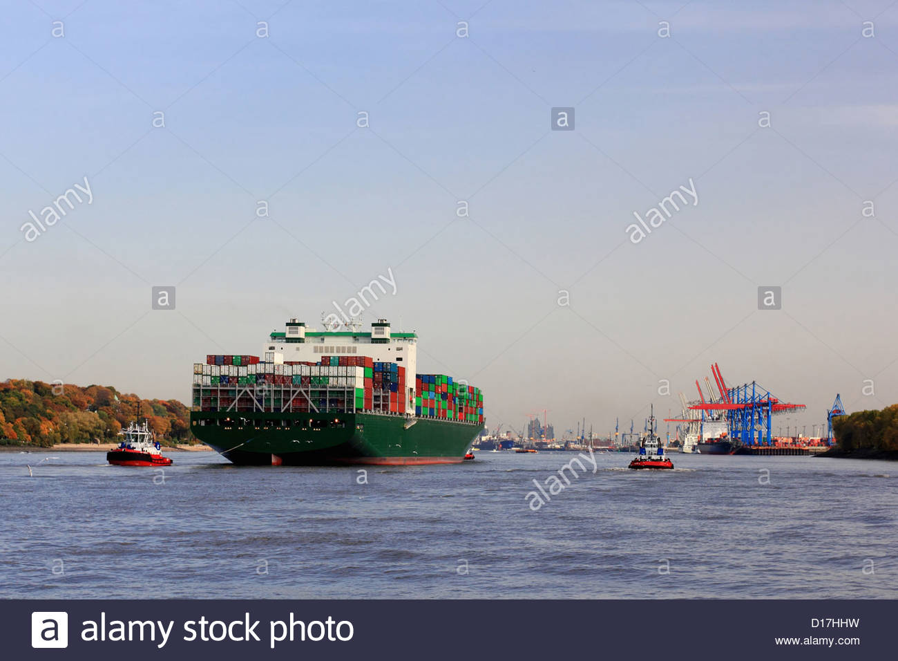 Container ship sailing on river - Stock Image
