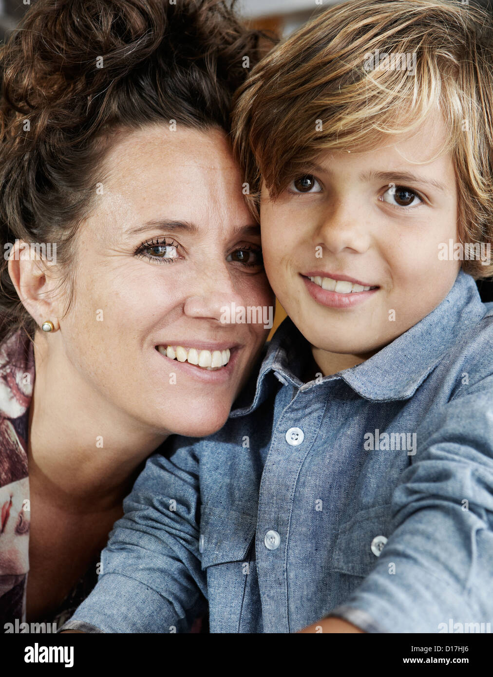 Close up of smiling mother and son - Stock Image