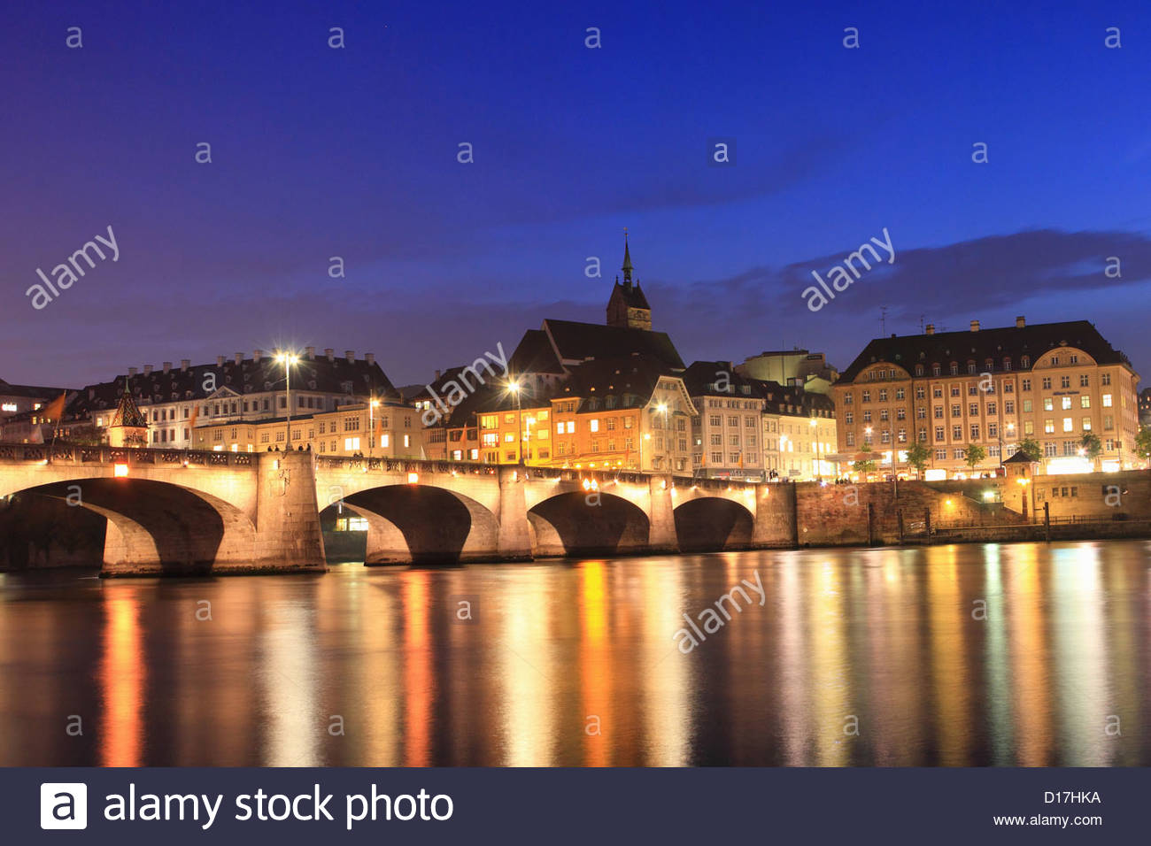 City lights reflected in river - Stock Image