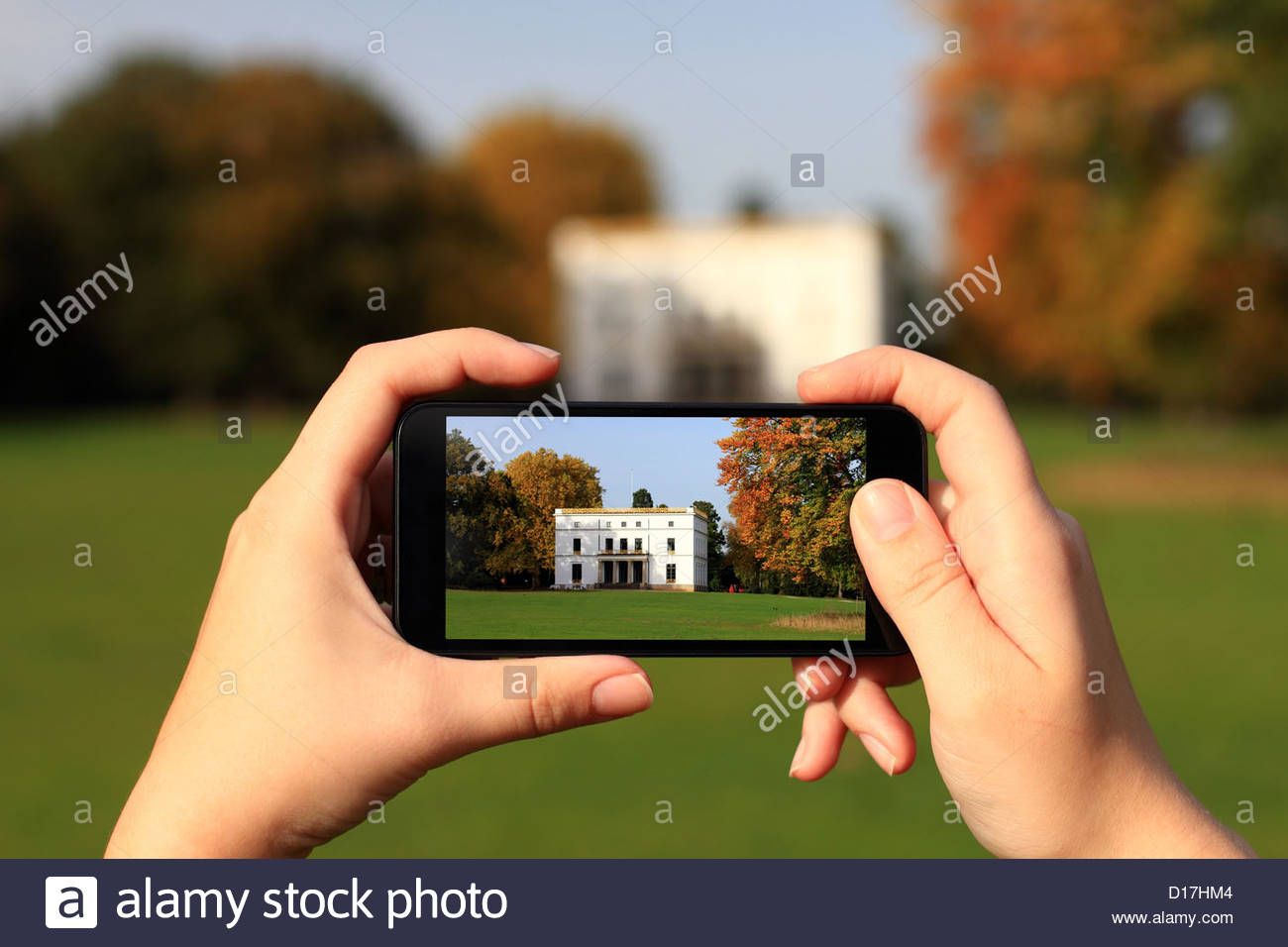 Hands taking picture with cell phone - Stock Image