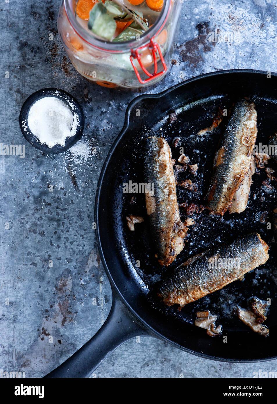 Pan of fried fish - Stock Image