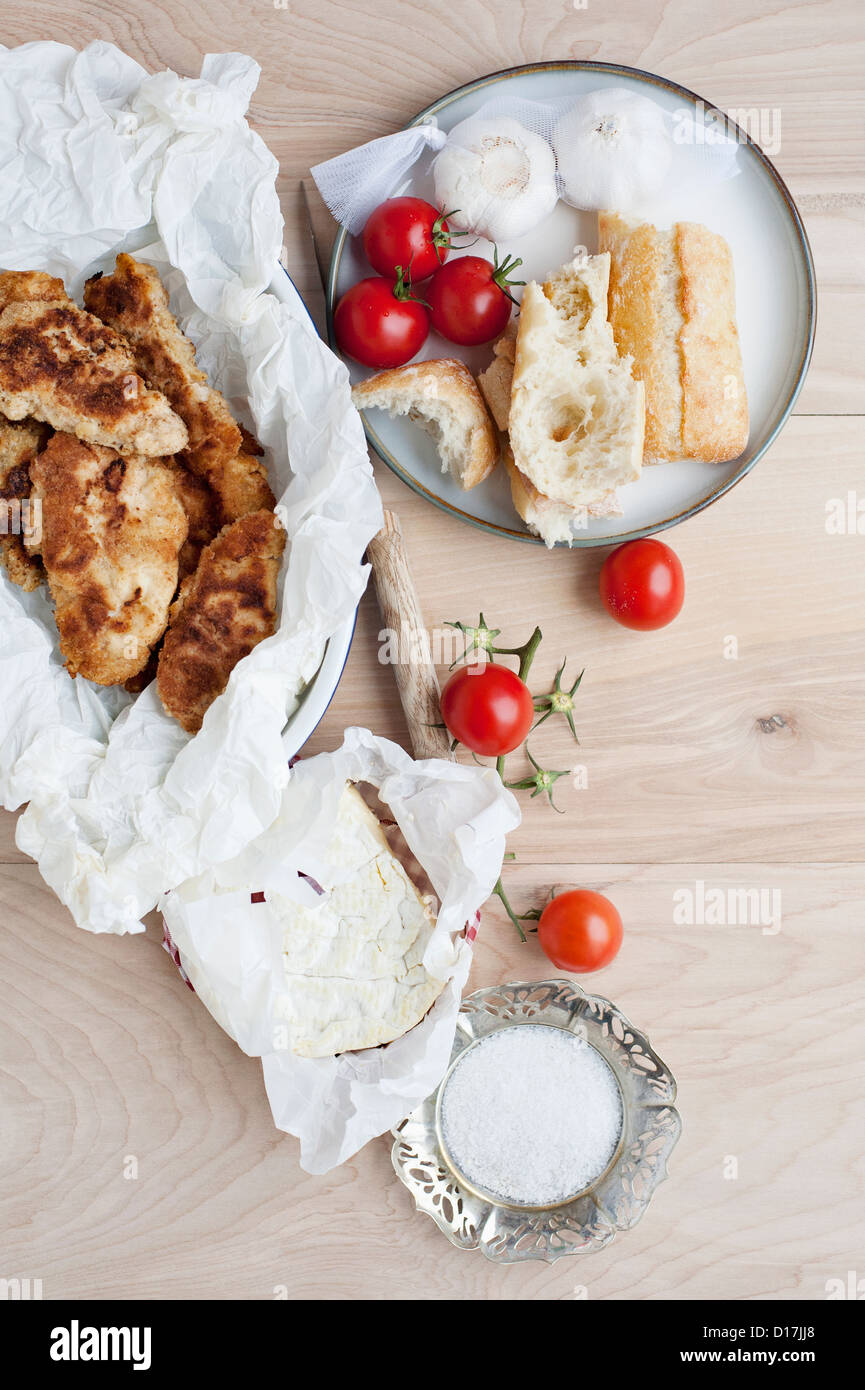 Bowl of bread with tomatoes and cheese - Stock Image