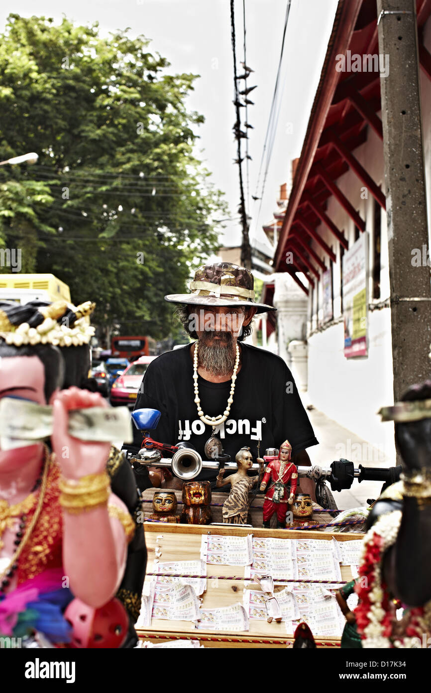 Street vendor with wares for sale - Stock Image