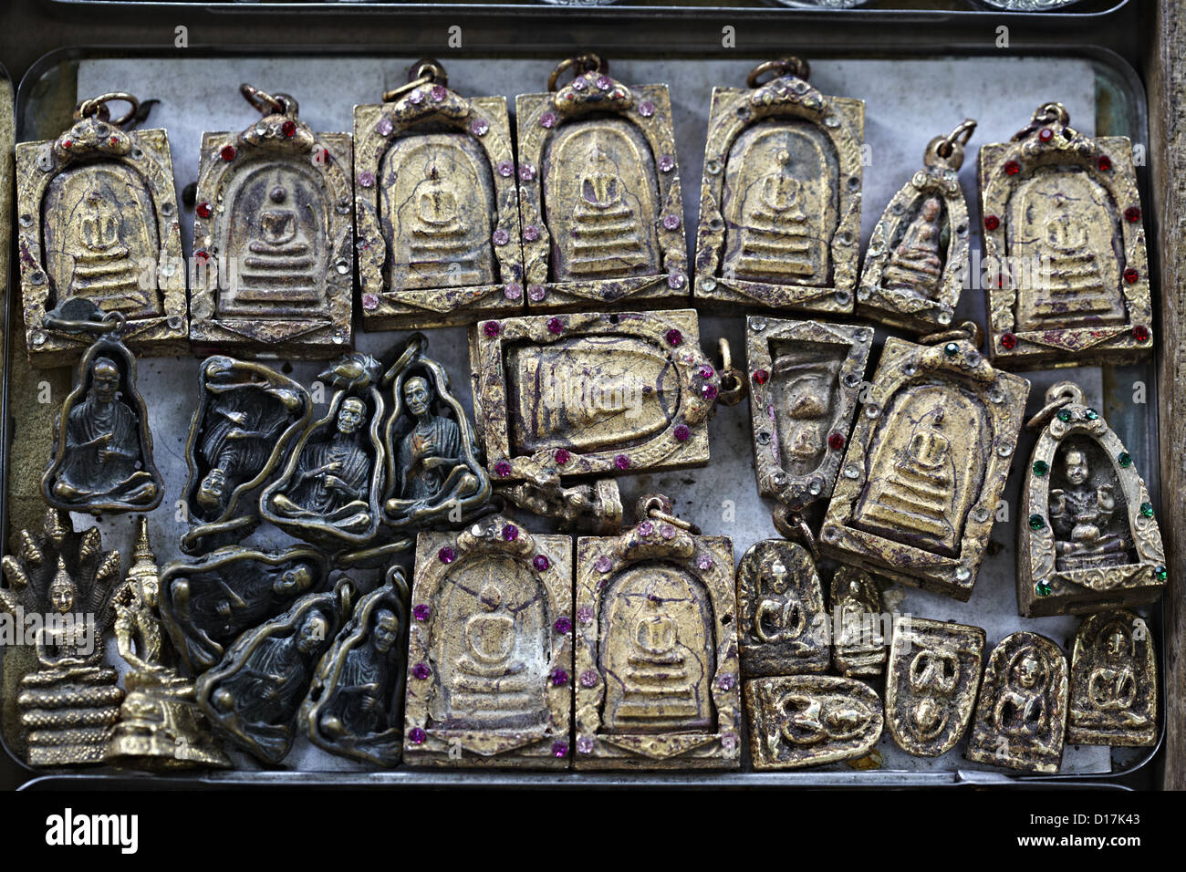 Religious relics sold by street vendor - Stock Image