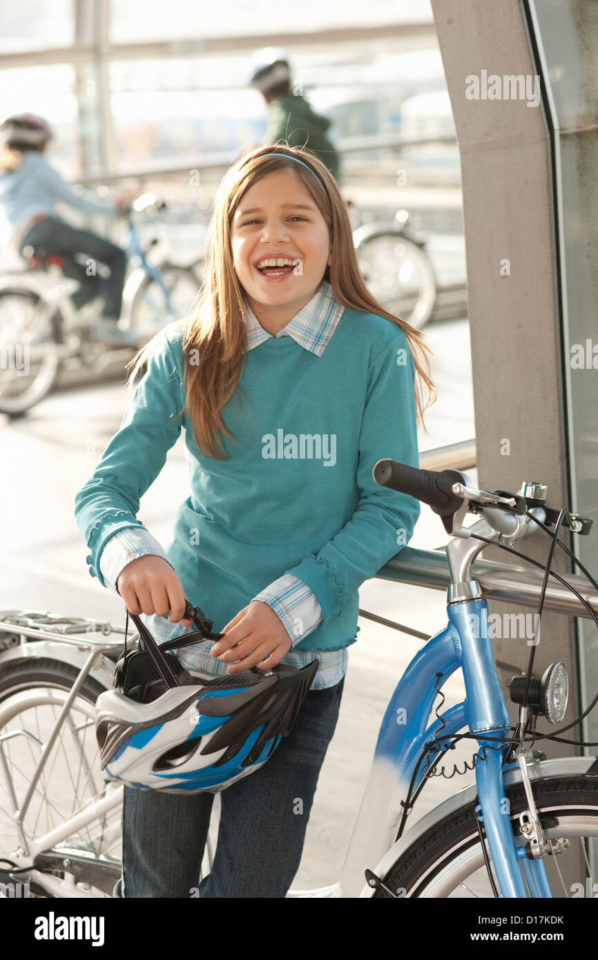 Girl with bicycle in city tunnel Stock Photo