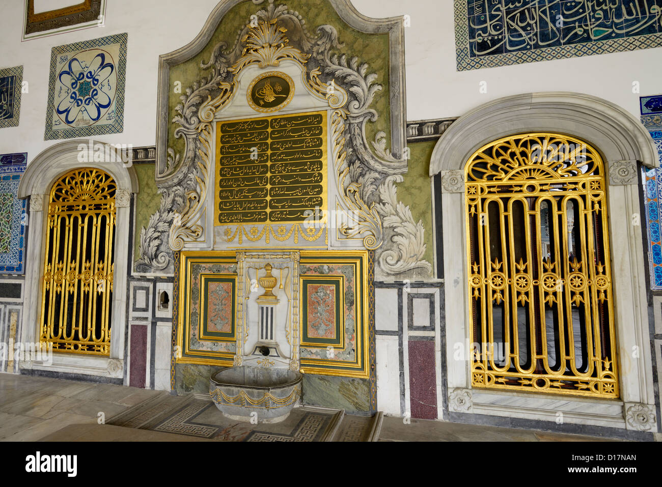 Gilded window and fountain outside the Pavilion of the Blessed Mantle Topkapi Palace Istanbul Turkey - Stock Image