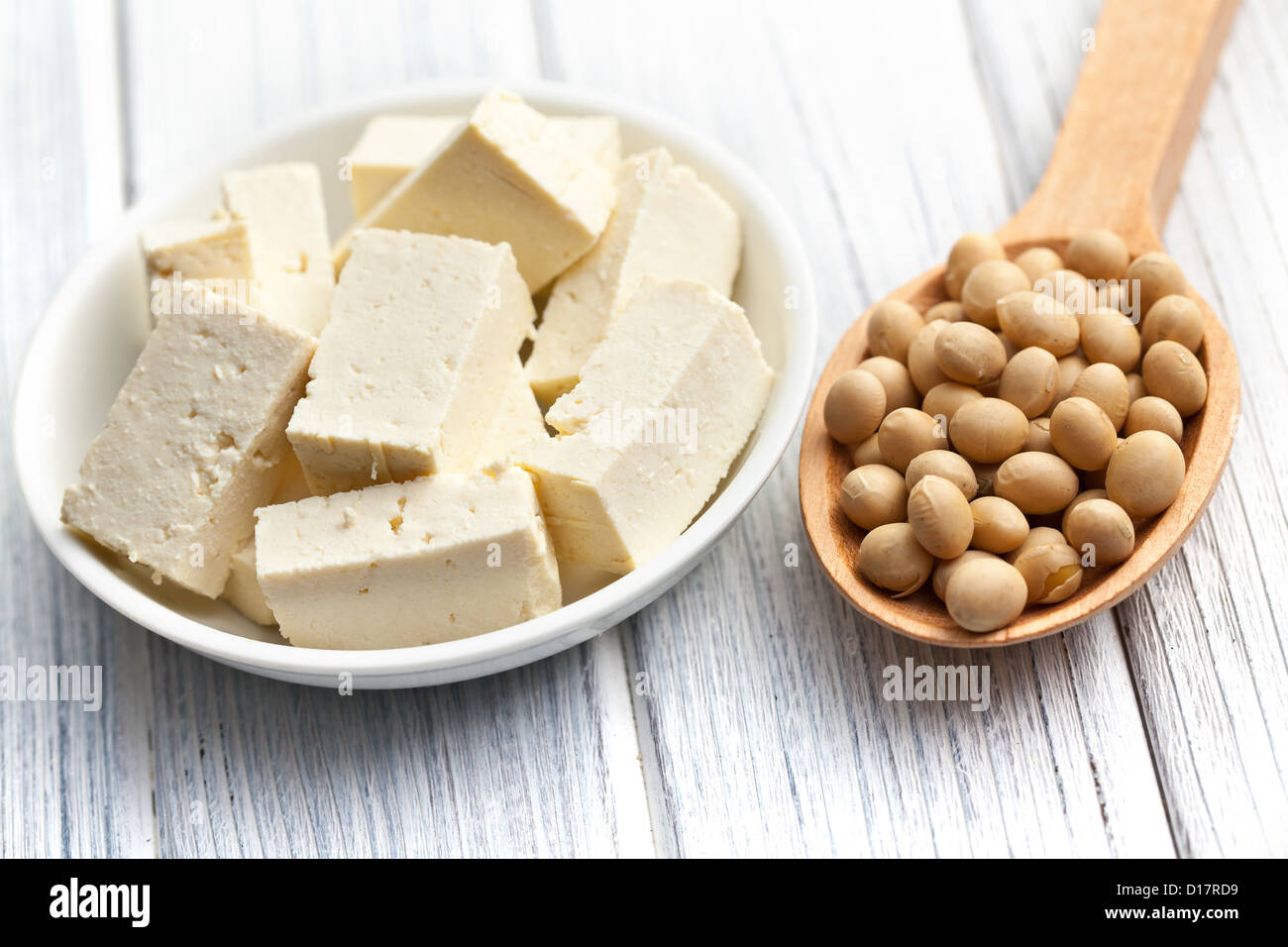 tofu and soy beans on kitchen table - Stock Image
