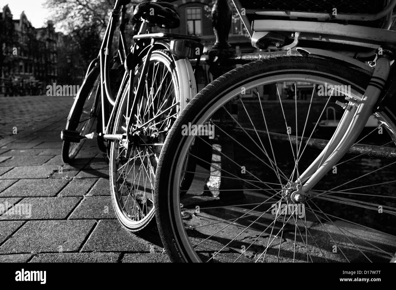 Holland, Amsterdam, bicycles parked by a bridge - Stock Image